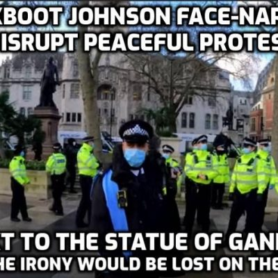Jackboot Johnson face-nappies disrupt peaceful protest in Parliament Square next to statue of Gandhi who said: 'The first principal of non-violent action is that of non-cooperation with everything humiliating' - COME ON PEOPLE IT IS TIME