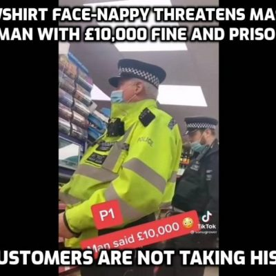 Super-arrogant and super-clueless Yellowshirt face-nappy threatens shopkeeper with £10,000 fine and prison time for not wearing a mask and damaging his health like the face-nappy is doing every day. Note the Blackshirt face-nappy in the background not even covering his nose. What a joke it all is - a fascist joke - but here the customers are not having it and Yellowshirt's a lot less  arrogant